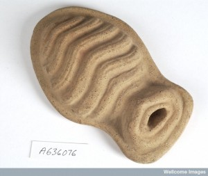 L0035934 Clay-backed uterus. Roman votive offering